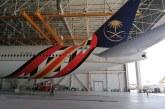 """صور.. طائرة الخطوط السعودية تتزين بشعار """"قمة العشرين"""""""
